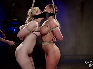 Two curvy slaves are bound at hand all directions each other at hand the hottest BDSM session