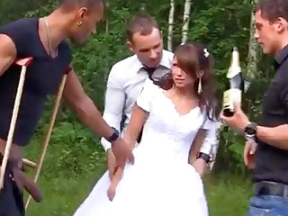 Russian bride enjoys an interracial gang-bang doused